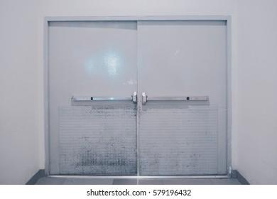 Grey big door and white wall