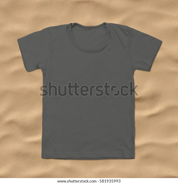 Grey blank t-shirt on dark sand background