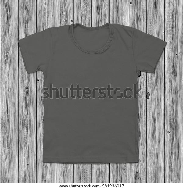 Grey blank t-shirt on dark wood background
