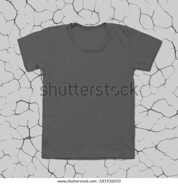Grey blank t-shirt on dark cracked background