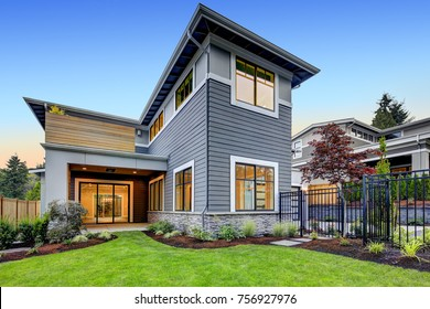 Grey blue craftsman style home exterior with Beautifully layered landscaping. Northwest, USA