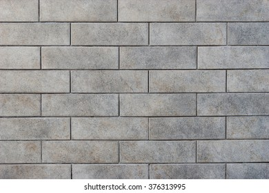 Grey brick tile wall background
