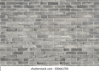 Grey brick wall texture background. Tiled.