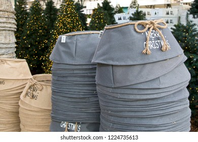 """Grey and brown jute bags to cover bottom of Christmas tree for sale. With text: """"Merry Christmas"""""""
