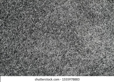 Grey canvas or velvet paper texture. Closeup