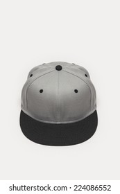 A grey cap top-side view isolated white background.