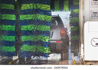 Grey car during washing process