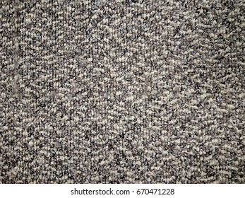 Grey carpet texture background from above