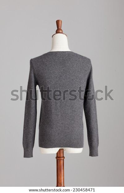 grey cashmere sweater with wood model on grey isolated