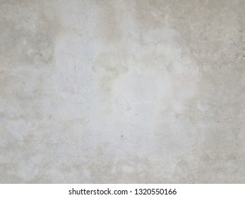 grey cement wall or surface with light patches