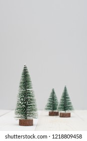 Grey christmas banner with green toy firs decoration