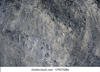 Grey cold ashes burnt in natural bonfire beautiful black contrast background