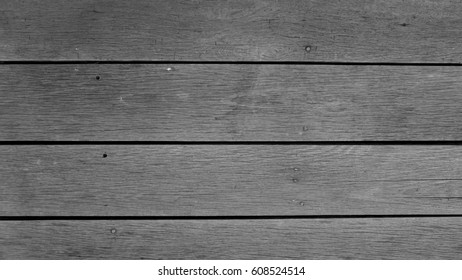 Grey color (greyscale/black and white) wooden floor or wall texture background with stripes horizontal line tiles