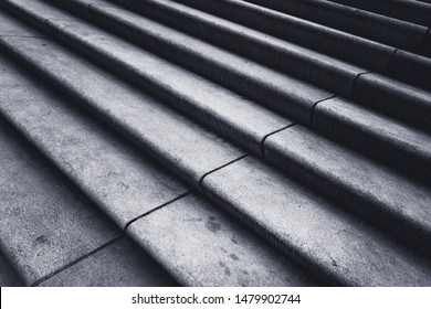 Grey concrete steps lead the way to the top