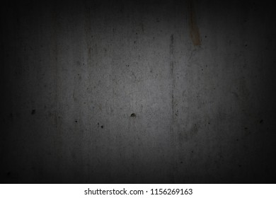 Grey concrete wall. Dark edges
