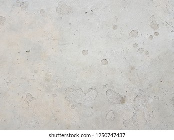 Grey concrete wall with flaws