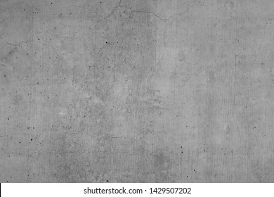 Grey concrete wall, texture with brushed textures, indiustrial design background in gray, with slight cracks and textures as a blackboard and design element and artwork.