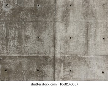 grey concrete wall useful as a background