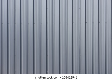 Grey corrugated steel cladding on a industrial building