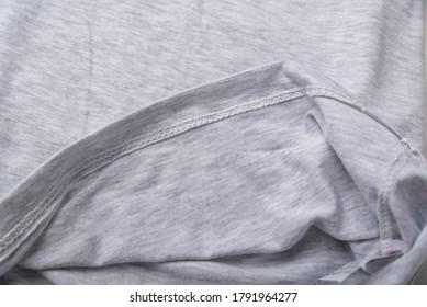 Grey cotton fabric close up. hem tee shirts, dress hem. fabric stitching. - Shutterstock ID 1791964277