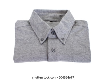 Grey cotton shirt folded on white backgroun