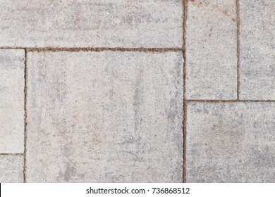Grey cracked stone coloured cement paving