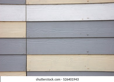 Grey and cream wood effect textured pvc cladding
