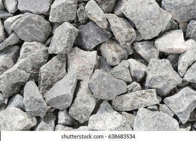 Grey crushed stones in close up; Versatile building material for horticulture, landscape gardening or road construction; Material for railroad construction; Filling material for gabion baskets