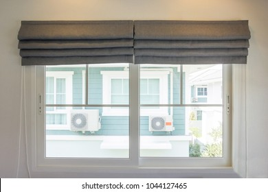 Grey curtain interior decoration in living room with sunlight