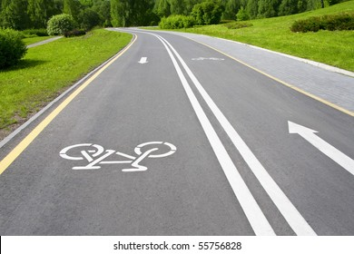 grey cycle track with white sign