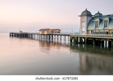 Grey dawn at Penarth Pier on the outskirts of Cardiff on the south coast of Wales