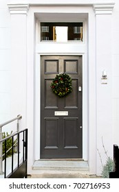 Grey door with wreath decoration for Christmas holiday