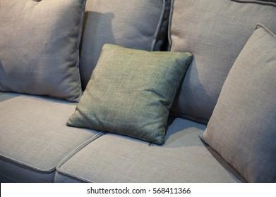 Grey fabric sofa with pillows, close up detail