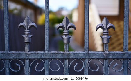 Grey fence with weapon lookalike elements symbolizing protection