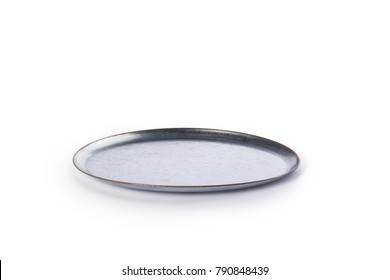 Grey and gold galvanized metal dish angle view against a white background