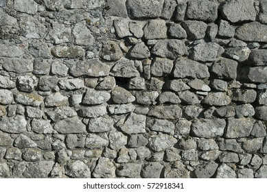 Grey granite wall background texture close up