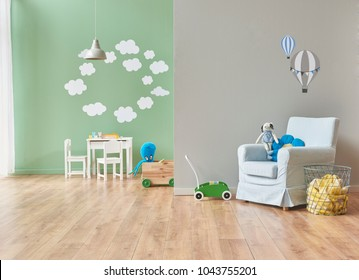 grey and green wall decoration modern baby room and all kind of baby object in the room. bed cabinet and toys style