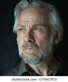 Grey haired man with beard