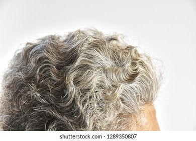 grey hair.half Gray hair with forehead of Asian woman on white background.Body that has deteriorated.Beauty problems of older women.eldery health concept.