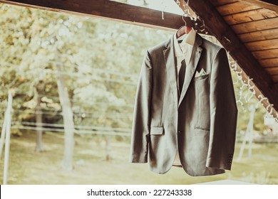 Grey jacket on wooden background