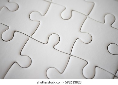 Grey jigsaw puzzle using as background education or business concept.