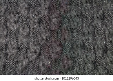 Grey knitting wool texture background, close up