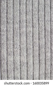 Grey knitting wool texture background.