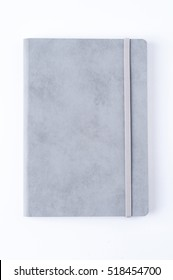 Grey leather notebook isolated on white background.