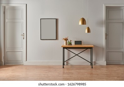 Grey living room, picture on the wall and two doors interior, wooden table and lamp concept.