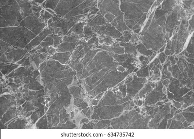 Grey marble texture shot through with subtle white veining (Natural pattern for backdrop or background, Can also be used for create surface effect to architectural slab, ceramic floor and wall tiles)