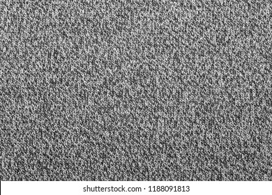 Grey melange knitted fabric made of heather mixed yarn textured background