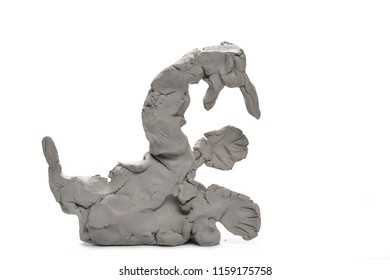 Grey modelling clay blocks, pieces isolated on white background