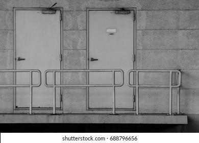 grey modern steel door at concrete building