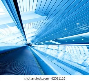 grey moving escalator